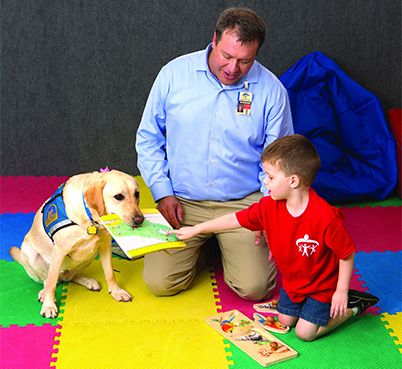 University of Saint Augustine Occupational Therapy Graduate works with children in his Great Strides rehabilitation center.
