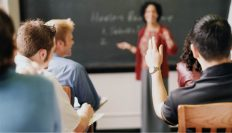 Teacher at chalkboard in classroom
