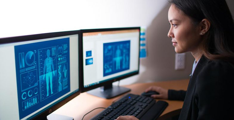 person looking at imaging on a computer screen